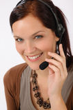 Friendly help desk woman smiling. Call center operator phone headset Royalty Free Stock Image