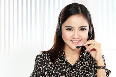 Friendly help desk woman smiling call center operator phone Stock Photo