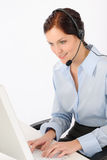 Friendly help desk woman typing computer Stock Photos
