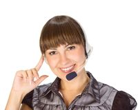 Friendly helpdesk girl. Portrait of a happy young woman wearing headphones Stock Images