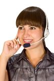Friendly helpdesk girl. Portrait of a happy young woman wearing headphones Stock Photography