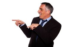 Friendly hispanic businessman pointing Stock Image