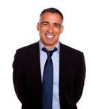 Friendly hispanic businessman smiling Stock Images