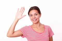 Friendly hispanic female with greeting hand Stock Photos