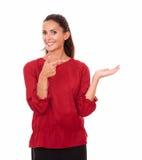Friendly hispanic female holding her left palm up Stock Images