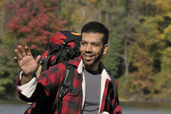 Friendly Hispanic Man Backpacking Royalty Free Stock Image