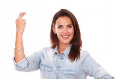 Friendly hispanic woman with lucky sign Stock Photo