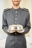 Friendly hotel page with cloche Stock Photography