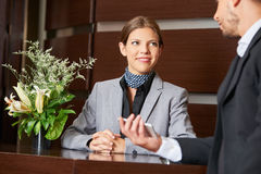 Friendly hotel receptionist and business guest Royalty Free Stock Image