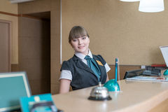 Friendly hotel worker posing behind reception Royalty Free Stock Photo