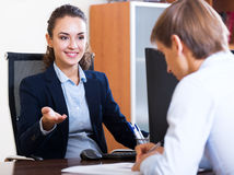 Friendly hr manager inreviewing competitor. Smiling hr manager inreviewing competitor for avalible vacancy Stock Image