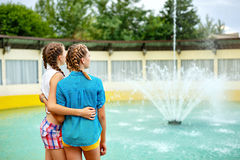 Friendly hug at the fountain. Stock Images