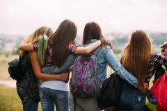 Friendly hugs admire nature tourism concept. Travelers group unity stock photography