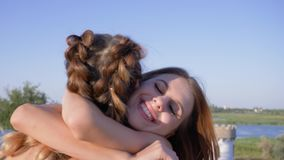Friendly hugs, happy girlfriends embraces at meeting and laughing close-up. On open air stock footage