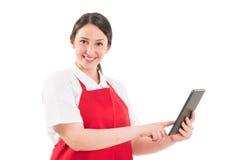 Friendly hypermarket female employee using tablet Royalty Free Stock Photos