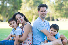 Friendly interracial family park outdoor Stock Images