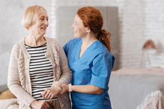 Friendly joyful nurse enjoying a chat with her patient Royalty Free Stock Photography
