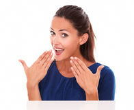 Friendly lady in blue blouse looking surprised Royalty Free Stock Images