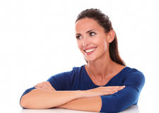 Friendly lady looking to her right, arms crossed Royalty Free Stock Photos