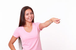 Friendly latin girl pointing to her left Royalty Free Stock Photo