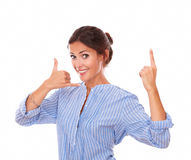 Friendly latin lady with call gesture pointing up Royalty Free Stock Image