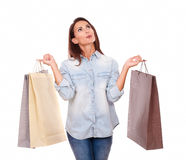 Friendly latin lady holding shopping bags Stock Images