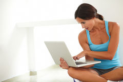 Friendly latin woman surfing the web Royalty Free Stock Photo