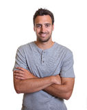 Friendly Latino with crossed arms Royalty Free Stock Photos