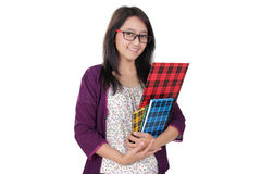 Friendly librarian lady. Friendly Asian librarian woman pose with some books and smile to camera, isolated on white background Royalty Free Stock Images