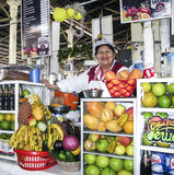Friendly local woman sells fresh juices to tourists Royalty Free Stock Image