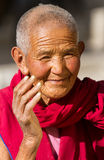 Friendly looking and smiling old buddhist nun from Jelichun nunn Royalty Free Stock Image