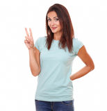 Friendly lovely woman with winning sign Royalty Free Stock Photography