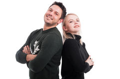Friendly lovers standing back to back Stock Photography