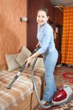 Friendly Maid Vacuuming Stock Photo