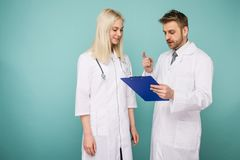 Friendly Male and Female Doctors. Happy medical team of doctors. Image stock images