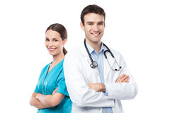 Friendly male and female doctors. Over white background Stock Photos