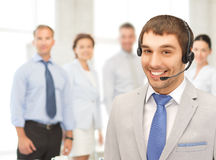 Friendly male helpline operator Stock Photo