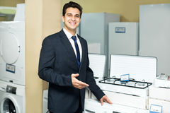 Friendly male seller at household appliances section Stock Photos