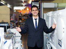 Friendly male seller at household appliances section Royalty Free Stock Photography