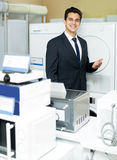 Friendly male seller at household appliances section Stock Photography