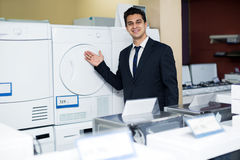 Friendly male seller at household appliances section Royalty Free Stock Photo