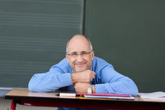 Friendly male teacher relaxing Royalty Free Stock Images