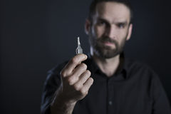 Friendly man holding and showing one key. stock photo