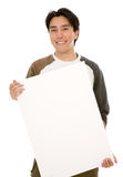 Friendly man holding a white board Stock Image