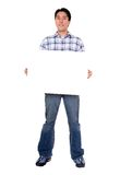 Friendly man holding a white board Royalty Free Stock Photography