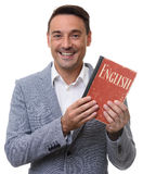 Friendly Man showing an English Textbook. Royalty Free Stock Photography