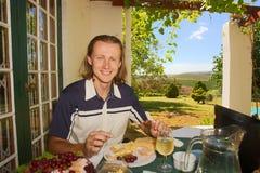 Friendly man smiles dining Royalty Free Stock Photos