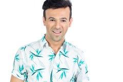 Friendly man smiles. Portrait. Handsome brazilian male wears sum. Brazilian man wearing a floral shirt, Hawaiian style. Summer, tropical Royalty Free Stock Photo