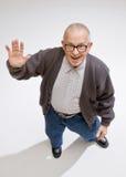 Friendly man waving. A greeting Stock Image