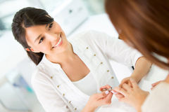 Friendly manicurist at the beauty salon Royalty Free Stock Photo